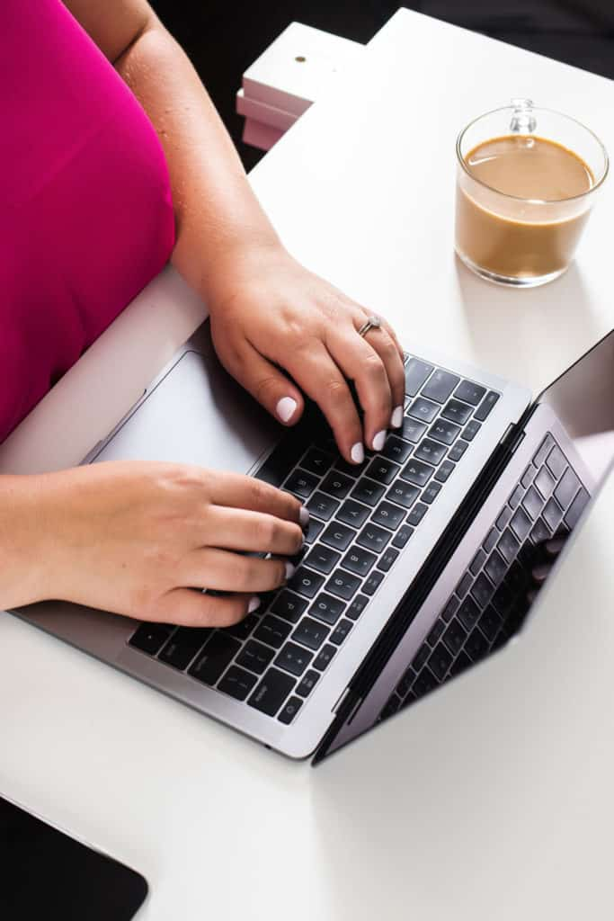 Woman typing on a laptop | providing digital marketing services